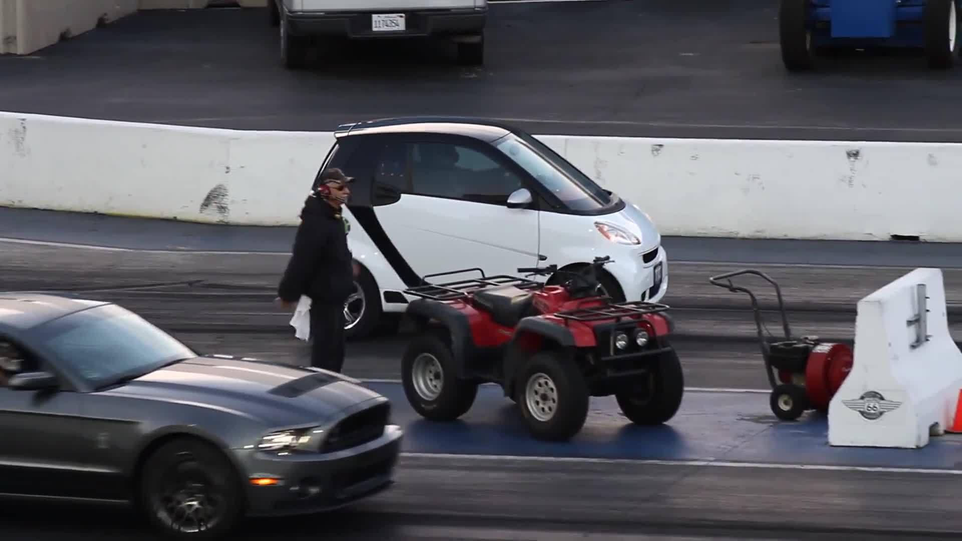 Smart Car Can Pops Wheelie And Outruns Mustang