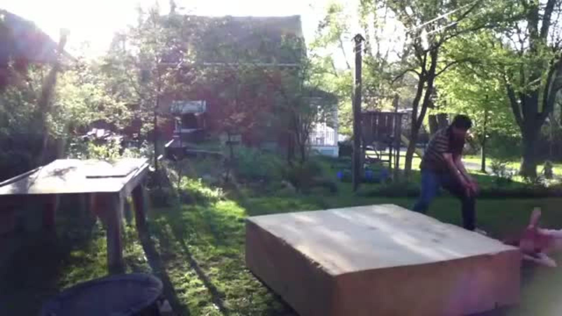boy does a scorpion off trampoline jukin media