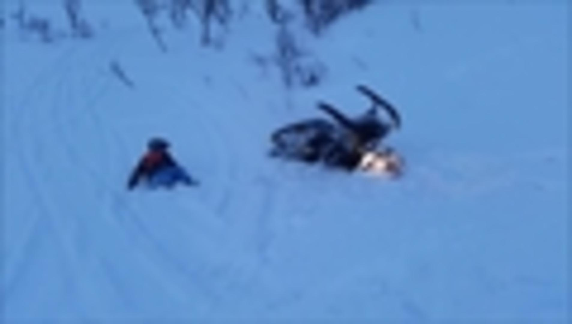 Snowmobile Rider Falls Off Snowy Cliff Jukin Media - This is what happens when you fly a snowmobile off a cliff