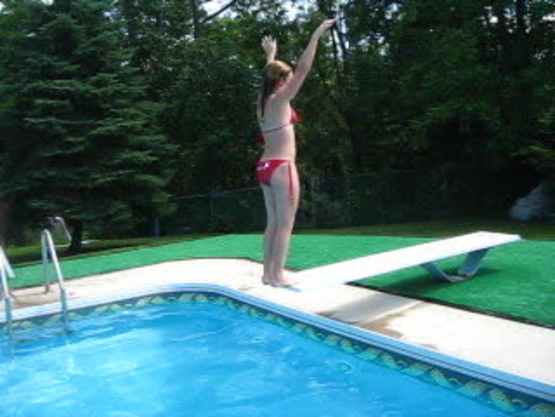 kid hesitates on diving board and faceplants on pool deck jukin