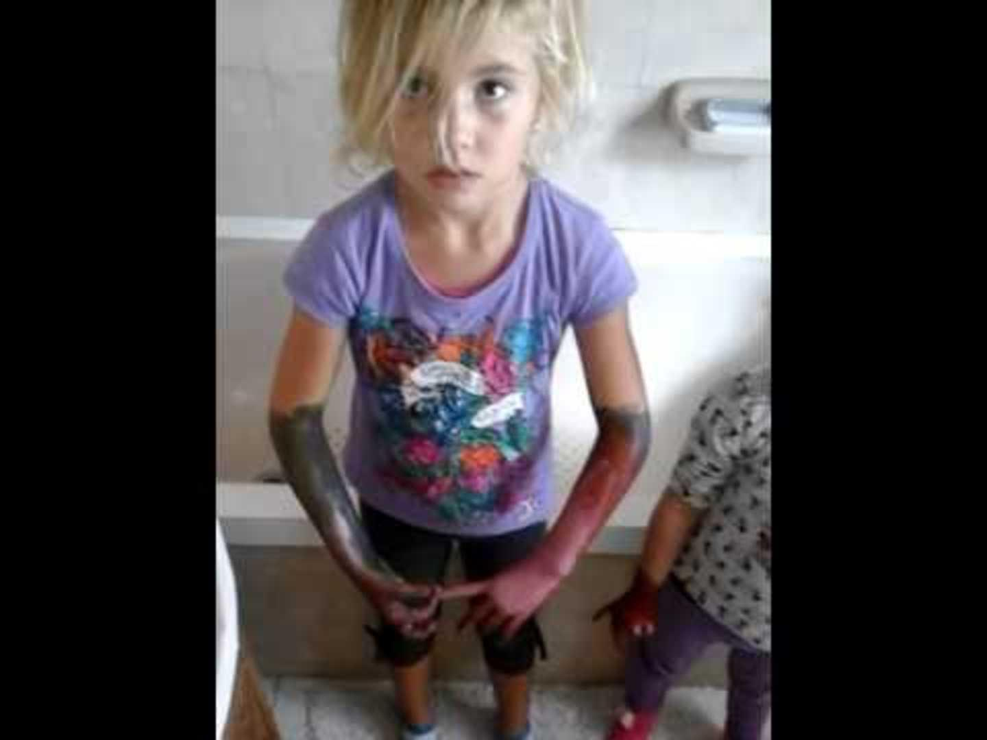 Little Girls Paint Each Others Arms