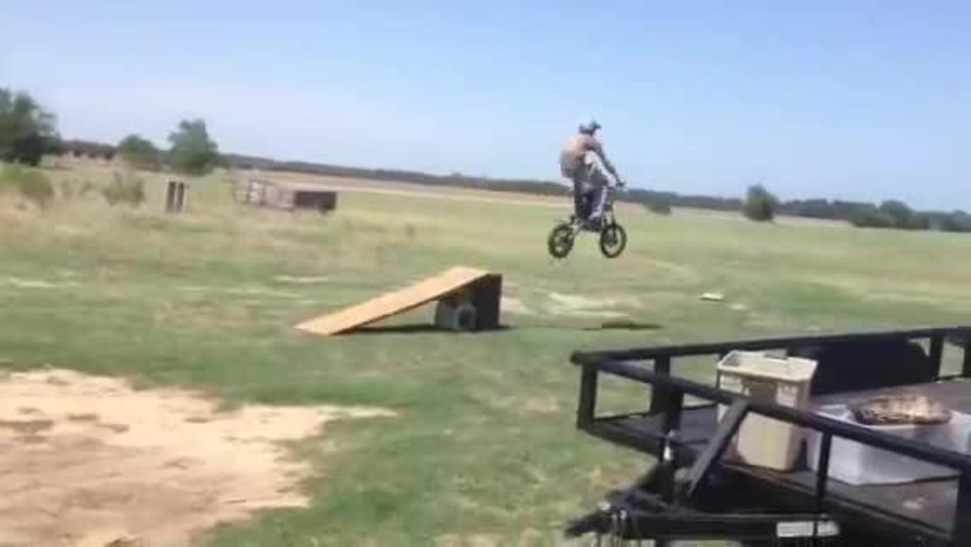 guy rides small dirt bike off ramp jukin media