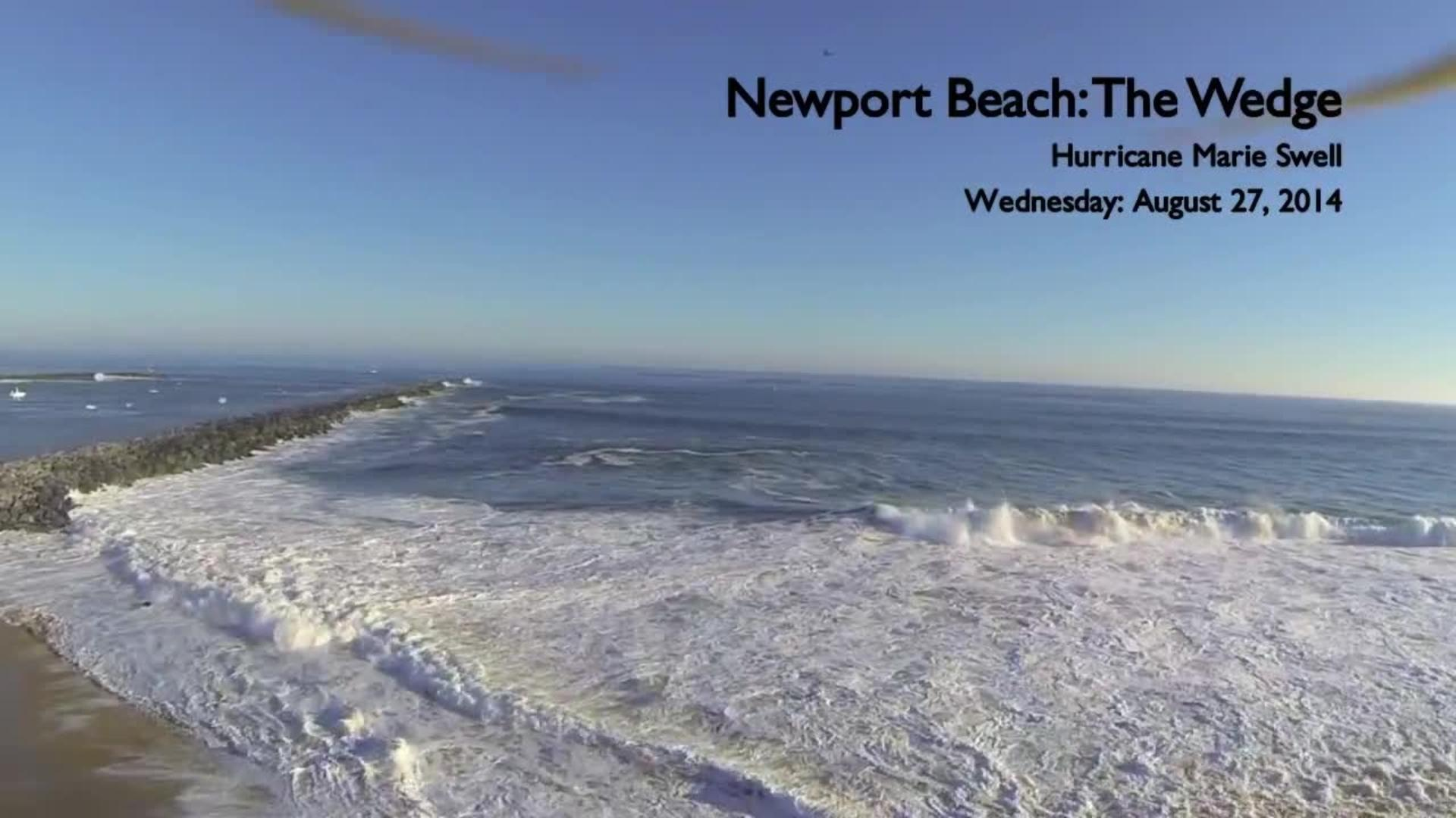 2 beach chairs on the beach - Drone Footage Of The Swell At Newport Beach Video 2
