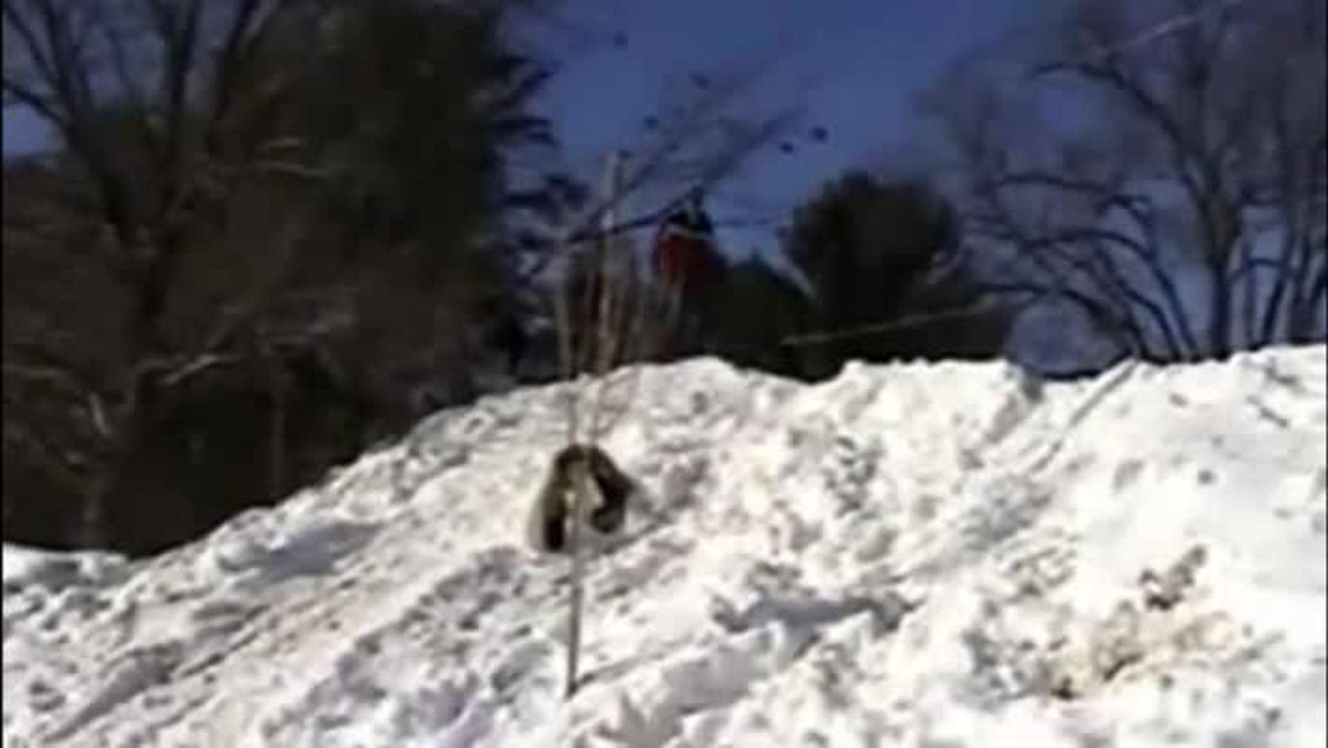 Snowboarding Jump Hits Fence
