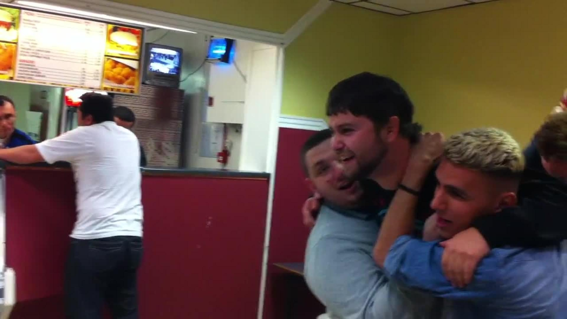 Guys Throw Friend Into Punching Bag Arcade