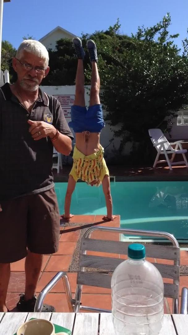 Senior Citizen S Flubbed Poolside Handstand Ends In Splash