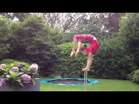 Woman Practices Flexibility on Balance Blocks | Jukin Media Inc