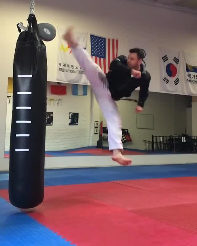Guy Kicks Paddle On Top Of Punching Bag