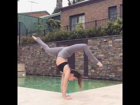 girl does splits and handstand next to pool  jukin media inc