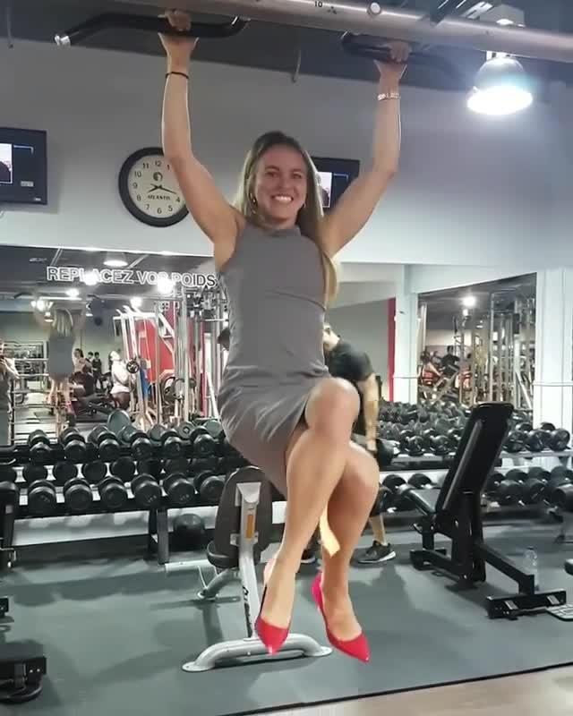 woman does pull ups with two fingers on hang board jukin media inc