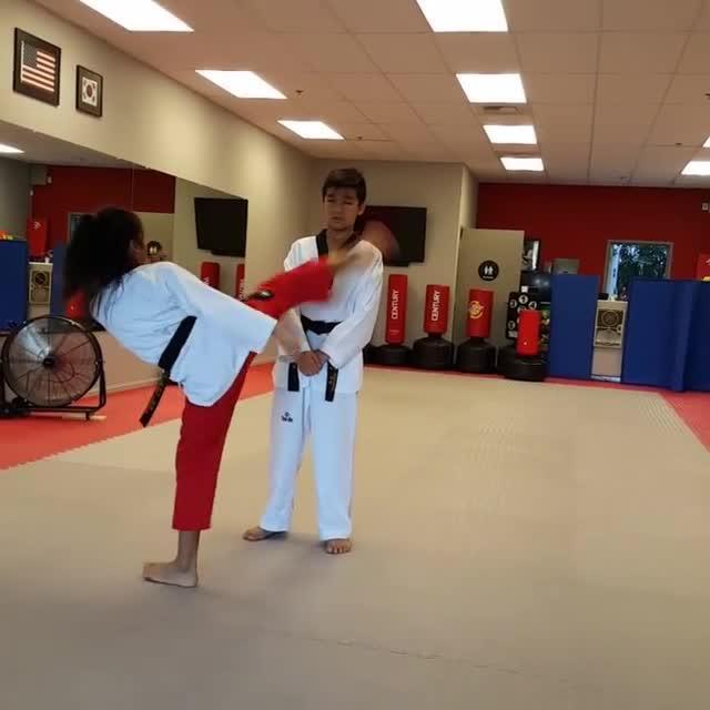 Little Girl Kicks Around Brother's Head | Jukin Media Inc