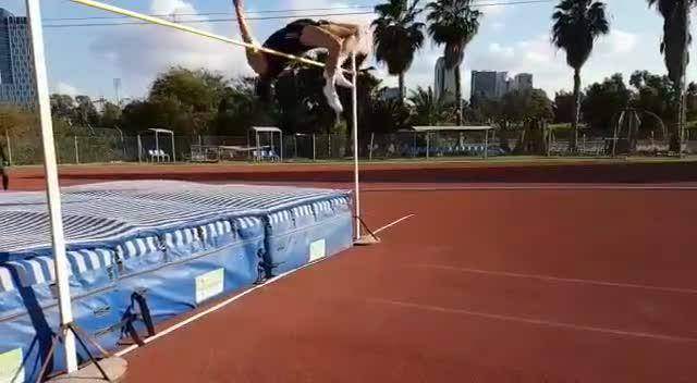 Guy Performs High Jump