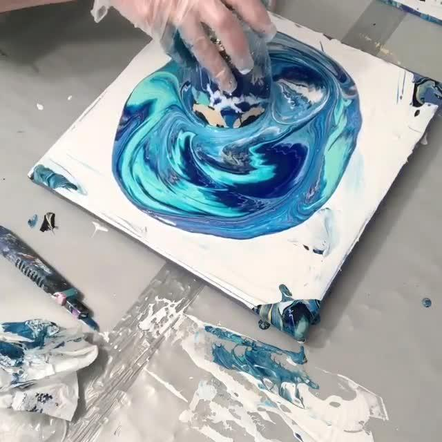 Artist Creates Piece by Pouring Paint on Canvas | Jukin Media Inc