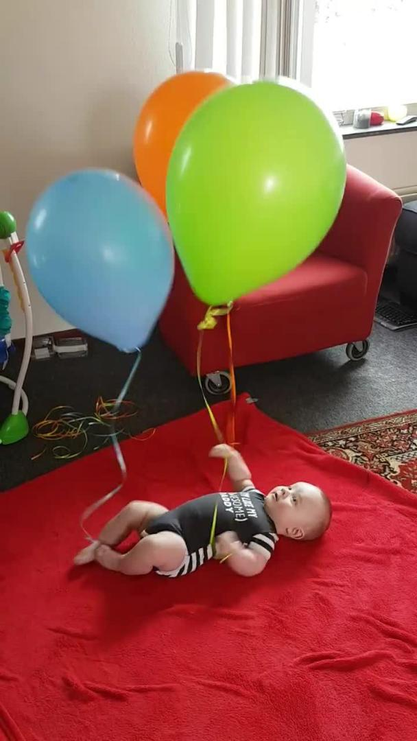 Father Knocks Around Helium Balloons With Ceiling Fan