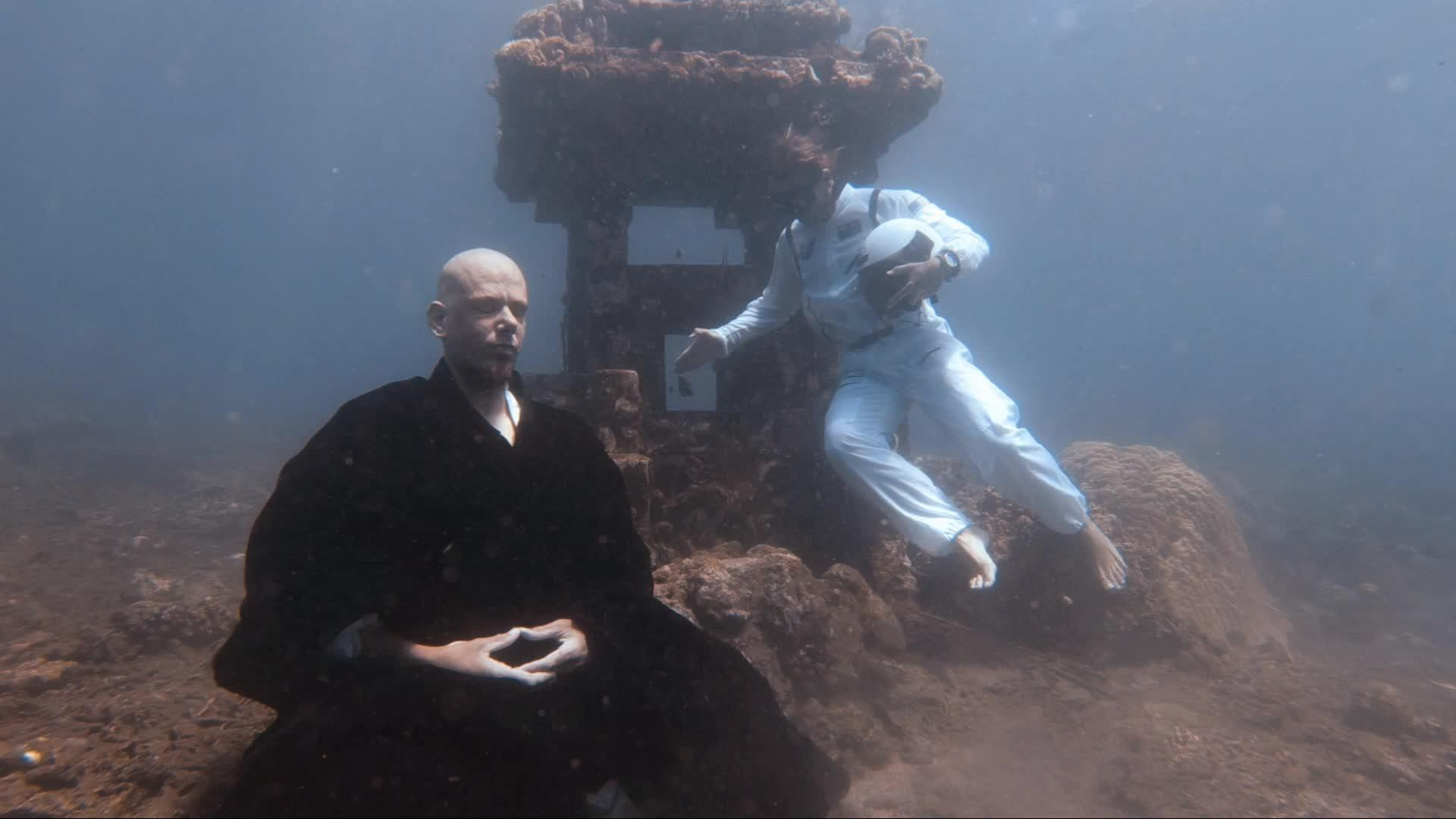 Monk Holds Breath and Meditates Next to Underwater Temple | Jukin Media Inc
