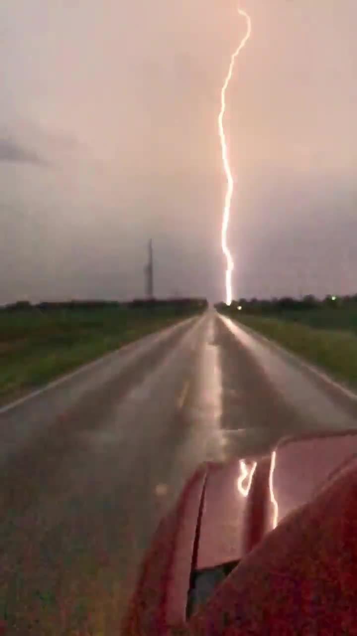 Lightning Spreads Across Sky over Highway Traffic | Jukin