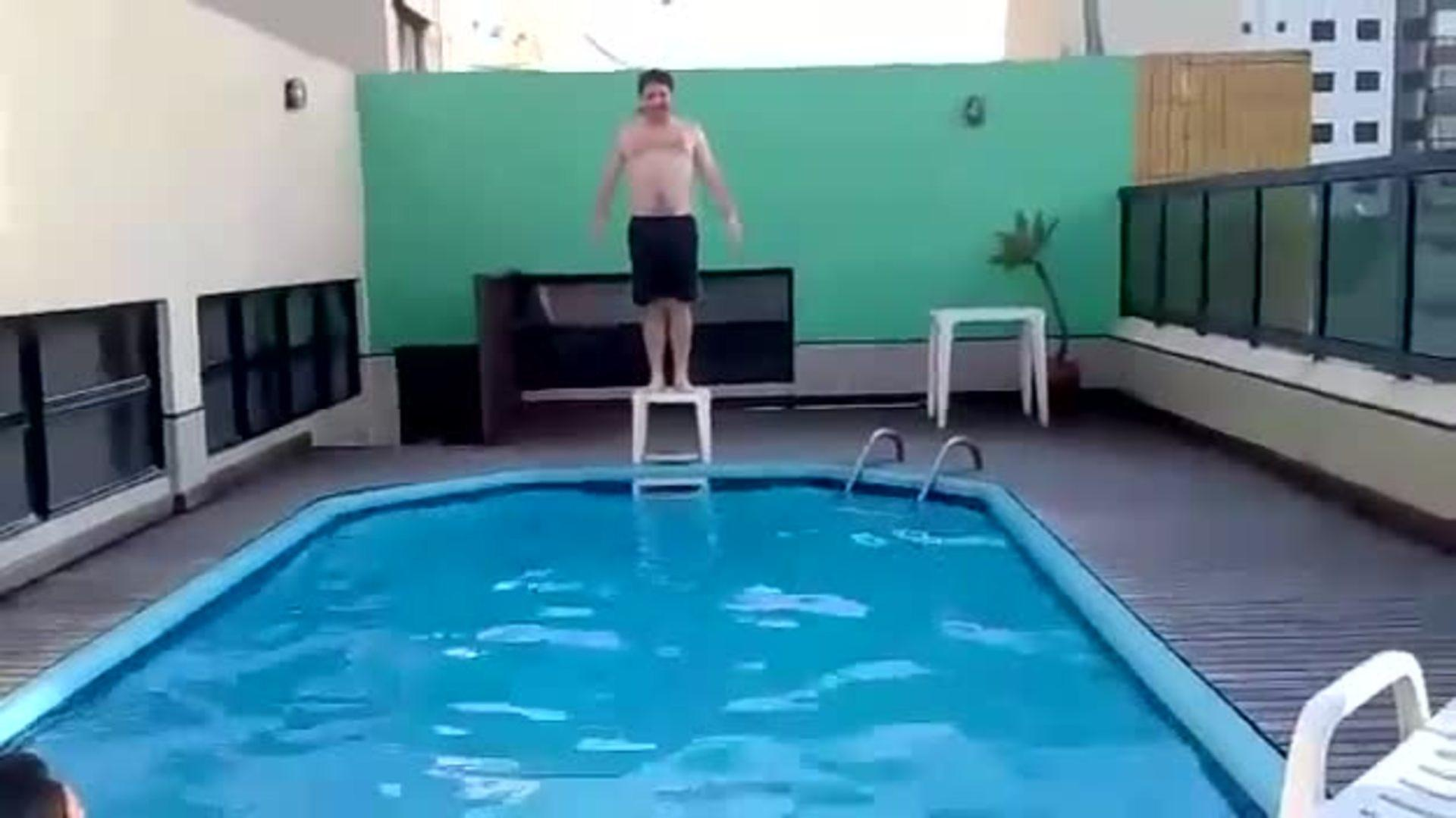 Guy Tries Jumping off Makeshift Diving Board | Jukin Media Inc